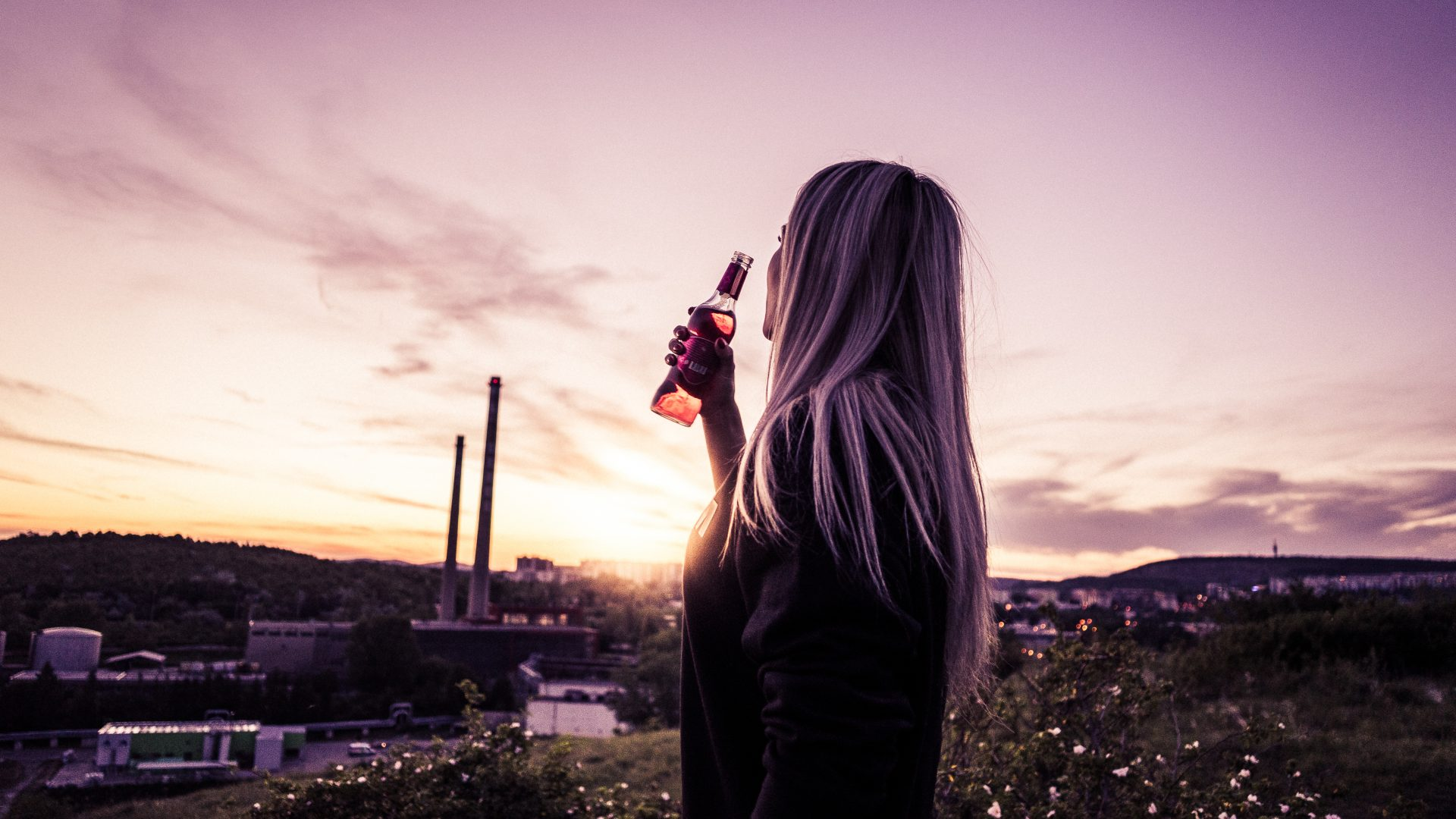 young-woman-enjoying-a-drink-in-sunset-picjumbo-com